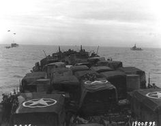 Vehicles and British troops on board LST off Utah Beach, Normandy, 9 Jun 1944 (US National Archives)