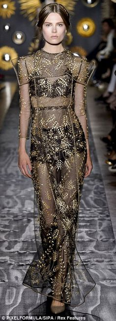 From the Orient: Oriental motifs and arabesque patterns fused with Scottish herringbone tweeds and Renaissance capes were thrown into the creative cauldron