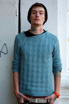 Such a simple adjustment to a basic blue sweater makes this look so cool.
