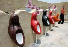 I bet you haven't seen urinals this weird! Check out our top list of the weirdest urinals ever. Public Bathrooms, Large Bathrooms, Plumbing Humor, Bathroom Humor, Ceramic Flowers, Interior Design Living Room, Funny, Weird, House Design