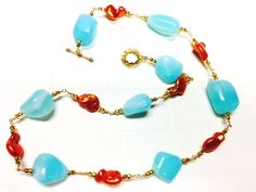 Stunning Peruvian Blue Opal smooth nuggets are hand-wire wrapped and married to gorgeous bright copper Freshwater Pearls with just a touch of golden pyrite to truly make this design shine! Light, bright and summery! The color combination radiates and allows you to match it to so many fabulous looks!  Stones: Peruvian Blue Opal nuggets, golden Pyrite, copper FW Pearls Materials: 14/20 GF wire, GF Toggle Clasp Matching earrings are shown and may be purchased seperately.
