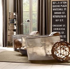 Vintage NYC subway sign, Avaitor chairs, wicked rocking side table, ascending ladder bookshelf, industrial floor lamp, large floor to ceiling windows.... what's not to love!?