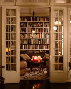 Festive Entertaining Tips from the Design Duo Behind Roman and Williams // in home library // library office designs // bookshelves