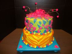 This cake was made for a 12 year old girl who came up with the design all on her own. She took a template right here from CC and colored it how she wanted it and I was just the one who made her vision reality. I give her the credit for the design. She was a very happy Birthday girl.