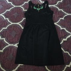 NWOT Cynthia Rowley Black V-Neck Dress Black v-neck dress rom Cynthia Rowley with hidden pockets, racer back, and zipper in back. Size large, new without tags. Cynthia Rowley Dresses Strapless