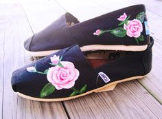 black tom shoes with pink roses painted on them