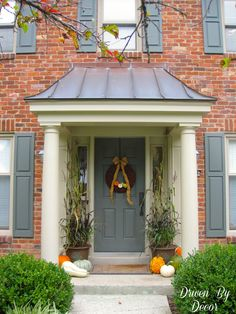 "Driven By Décor: Decorating My Front Porch for Fall - I love the look of the columns and pretty roof on this portico.  There is a ""before"" pic that is hard to believe!  Huge difference."
