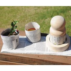 Teach your preschoolers to #recycle old newspaper into perfect seedling pots!