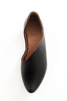 Black asymmetric flats with a pointy toe shape - by UNA-UNA