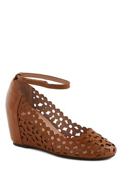 The Conservatory at Twilight Wedge in Brown. While sunlight makes petals seem to smile, moonlight allows them to glow with the same mystery that these whiskey-brown wedges - Jeffrey Campbell's Delaisy - embody. #tan #modcloth