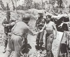 Marine Col Chesty Puller greets a Navy Admiral at the 1st Marines command post on Peleliu, Sep 18 1944.