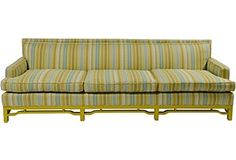 60's three seat sofa with lacquered base