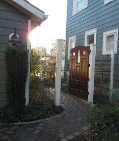Reclaimed door as a garden gate