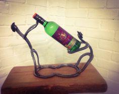 Items similar to Horseshoe cowboy wine bottle holder on Etsy Horseshoe Projects, Horseshoe Crafts, Horseshoe Art, Welding Works, Metal Welding, Bottle Rack, Wine Bottle Holders, Types Of Welding, Gardens