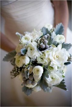 Winter Bouquet {Artistic Blossoms} #weddings -- hadn't thought about spraying some leaves gray?? There are also some gray succulents...