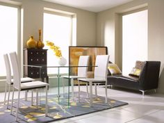 The glass on glass dining table with Arcane chairs is the ideal fit for small and mid-sized dining rooms.
