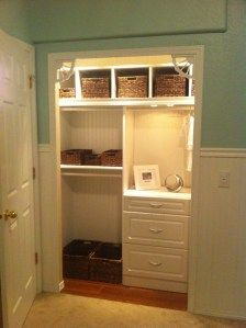 Custom kids/Nursery Closet. Dimming lights, child-size clothing racks, wicker basket organization, beadboard paneling
