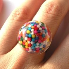it looks like it's filled with sprinkles or tiny gum balls. either way, delicious.