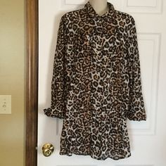 Jaclyn Smith Long Animal Print Top Buttons down the front and button cuffs on sleeves.  2 small pockets on top front of blouse.  Gold buttons.  100% cotton.  Made in Bangladesh. 32 inches from shoulder to bottom of top. Jaclyn Smith Tops Blouses