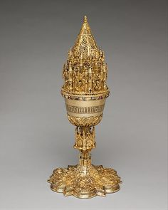 The rare openwork cover on this Spanish chalice, with its elaborate ornament drawn from late Gothic architecture, nearly overwhelms the form of the vessel itself. The exterior of the bowl is engraved in Gothic letters with the Latin text of the Hail Mary— AVE MARIA GRACIA PLENA DOMINUS [TECUM]—the greeting of the Archangel Gabriel to the Virgin Mary when he announced the forthcoming birth of Jesus