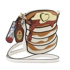 "Got syrup? If you said ""of course!"" then we have the perfect purse for you: this faux leather flapjack stack of a bag by Betsey Johnson! From the heart-shaped pad of butter to the maple syrup and whipped cream hang-tags, it's simply delicious!"