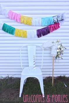 layla's ponies and unicorns party - tissue paper fringe decorations, paper hobby horse races and unicorn horn party hats