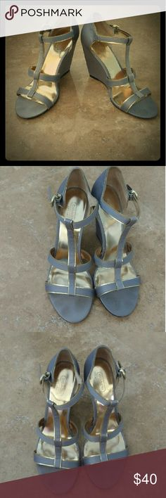🎉HP🎉8/15/16🎉 Coach gray satin wedges Only worn a couple of times. Shoes don't show any real use. Super comfy to wear. Thy are a gray satin with gold accents. Super cute to wear. Coach Shoes Wedges