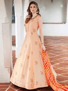 Cozy peach embroidered gown online at best shopping price. Shop this latest gown style for diwali celebration. This alluring style set comprises a silk gown with matching georgette dupatta and crepe bottom.