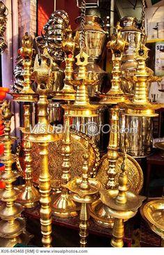 Brass oil lamps at a shop in Kollam, Kerala, India