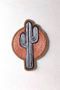 Meet me at sundown... The Sundown Cactus Patch is carefully hand embroidered with tiny stitch detail and bright peach sun. The newest piece in a growing