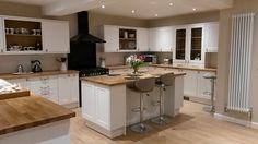 Our new Burford White Howdens Kitchen - interesting black oven