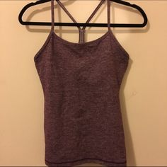 Heathered dark purple power Y tank Classic Lululemon power y in a such a pretty color! Lightly worn, size dot confirmed size 6. No trades, no PayPal and I only sell on poshmark lululemon athletica Tops Tank Tops
