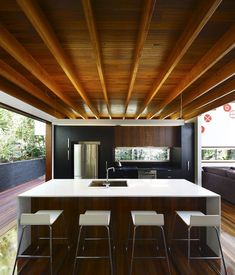 Horizontal windows, island, back panel of cabinets @ Lockyer Residence by Shaun Lockyer Architects Arkhefield (7)