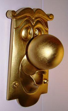 For the toy cubby door.   Alice in Wonderland Disney DOORKNOB Character Figure Resin Display Sign Prop. $54.25, via Etsy.