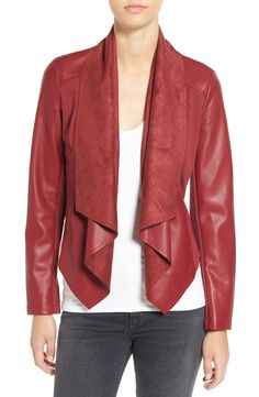 This trendy jacket spotted at the Anniversary Sale definitely stands out from the rest. It's made with a trio of textures, and has an elegant front drape. This will be a great jacket to wear for chillier nights out this fall.