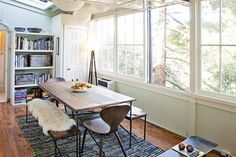 Jesse's Modern Bachelor Pad. Love the sheepskins on the reclaimed vintage wood benches at this dining table.