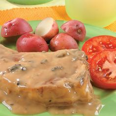 Garlic Pork Chops- very very easy to make, using milk, garlic cloves, and a can of Campbell's Mushroom soup! Nice and flavorful!