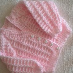 I first made this cute cardigan in Pink, and my friend said her daughter would love one for her new baby boy, so I did this for her as a gift.