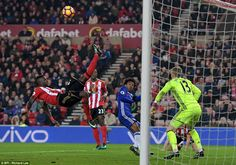 Defender Djilobodji acrobatically clears the ball away from danger as Willian misses out in the Sunderland penalty area