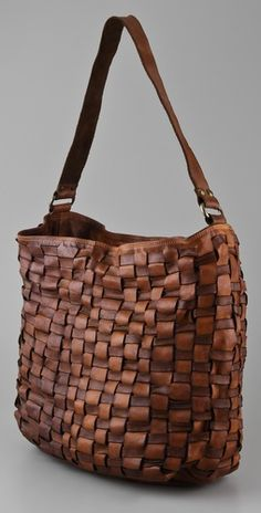 ONE by Campomaggi Woven Bag  We could find something like this if a plain basket is too awkward to carry around. I like the idea of modernizing that character accessory.   Lindsey - Red Riding Hood