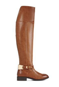 Lisander by JustFab is a tall flat boot featuring buckled ankle strap detail with metallic plate hardware at the back.