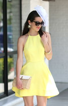 Bright yellow Derby Day-inspired halter dress from the Mint Julep Boutique with a classic white fascinator hat. Love it.
