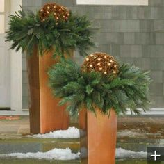Column Planter We could spray paint wood, gold to make a planter and then make a less holiday looking arrangement with greens, branches and twinkle lights. Christmas Urns, Christmas Planters, Christmas Arrangements, Outdoor Christmas Decorations, Winter Christmas, Christmas Home, Christmas Lights, Christmas Wreaths, Christmas Crafts
