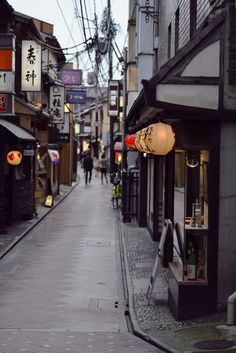 Oh this looks so familiar and cozy.  I remember walking the non-tourist area streets of Japan, exploring with my little girl. Such a fascinating place. Kyoto Street, Japan