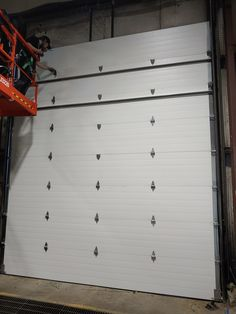 At Precision Garage Doors, we install all varieties, makes and designs of commercial garage doors. We offer the highest quality assistance with the lowest guaranteed estimates for all commercial garage door installations. Garage Door Track, Garage Door Repair, Precision Garage Doors, Affordable Garage Doors, Commercial Garage Doors, Garage Door Installation, Heavy Equipment, Home Depot, Vehicle Lift