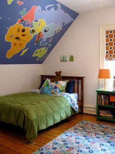 I like where the map is but not the map itself. greay way to use a slanted ceiling! Wanderlust: Map Decor in 20 Inspiring Kid's Rooms