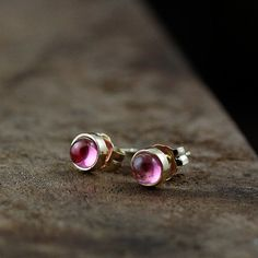 Love these: 14k gold pink tourmaline stud earrings by AndreaBonelliJewelry, $175.00
