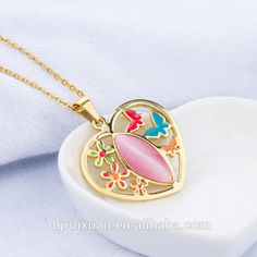 Heart shaped with inner flower and butterfly stainless steel pendant. Cute and elegant .