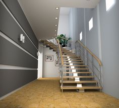 Open riser staircase in a modern home.  Again featuring open risers, these stairs keep this relatively narrow space from feeling claustrophobic. The curve in the staircase allows for a break in the stairs without the use of a landing.