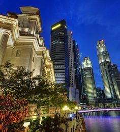 The Fullerton Hotel still holding its old world charm at the mouth of the Singapore River